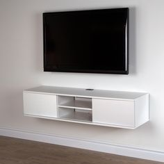 The light, airy style makes this a compact media console with maximum storage space. This contemporary wall mounted piece helps you free up space so you can say goodbye to the clutter that often happens in the TV area. Features: Can hold up to 165 lb total 6 storage spaces separated by 2 adjustable shelves that can support up to 15 lb Sliding door means you can choose the configuration of your open and hidden storage spaces Rounded corners for more safety Console hangs on wall, so floor is…