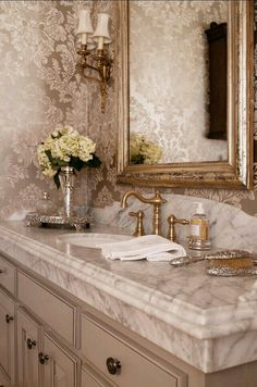 Love the sink top, faucets, and color of cabinets..