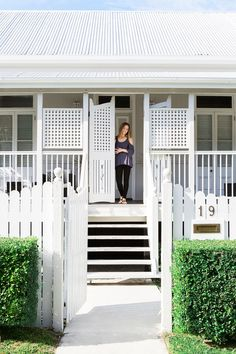 The picture-postcard facade of this classic urban Queenslander includes French doors and latticework verandah screens. New chamfer boards clad both the old and new sections.