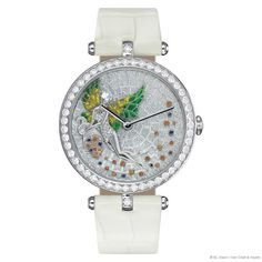 Extraordinary Dial™, Lady Arpels Fortuna decor, Van Cleef & Arpels: white gold and diamond paved case, micro-mosaic of enamel, stained glass enamel, gold sculpting, stone setting dial, Swiss mechanical movement. – photo via Van Cleef & Arpels