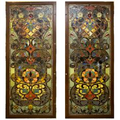 William D. Somers impressive Tiffany style stained leaded glass doors. Each has hinges one side and four holes on the other, perfect for hanging. Price shown is for the pair.