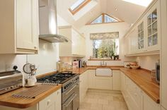 Similar room re pitched roof , velux's and window at end . Love the kitchen - work top and sink esp. Open Plan Kitchen Living Room, Kitchen Dinning Room, Building Extension, Extension Ideas, L Shaped Kitchen, Kitchen Upgrades, Kitchen Images, Kitchen Styling, Foyer