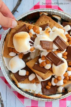 A fun way for the entire family to enjoy s'mores right from the grill!  Ready in under 10 minutes, and topped with all your favorites, these easy and delicious S'mores Nachos will having you going in for more!