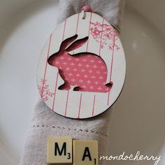 cute cut out bunny tag decoration - here used as napkin holder but would also be cute hanging in easter tree or on a banner