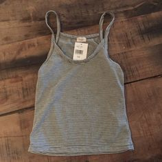 ❤️SOLD❤️Brandy Melville John Galt James Crop Nwt John Galt  James Cropped striped tank top one size but it's def an xs. The stripes are dark charcoal grey and white and has a scoop neck line. Was $22.14 with tax and shipping - can include receipt Brandy Melville Tops Tank Tops