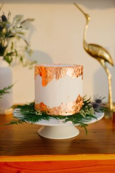 Gold leaf details make this cake a stunner! Sweets by Millie
