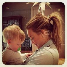 Hilary Duff cuddled with son Luca Comrie, who loves buttons.