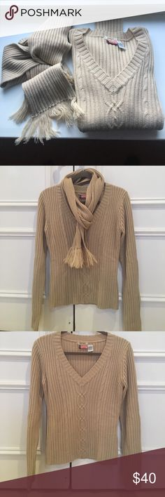 Sweater with matching scarf. Cute for spring. V neck with cable knit front. Great look with or without fringed scarf which can button to sweater (see pic). Two small stains, on scarf and on inside will likely wash out. Hand wash, lay flat to dry. Poetry Sweaters V-Necks
