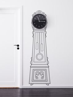 Create a personal grandfather clock, by framing an ordinary wall clock with the MORTORP decorative sticker.