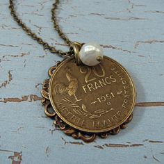 cute idea to take an old coin and make a necklace out of it! - SO LOVELY!! 🔮
