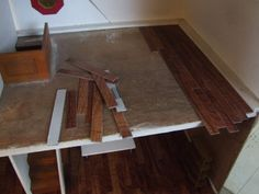 How to: Dollhouse flooring with vinyl wood tiles from Home Depot.