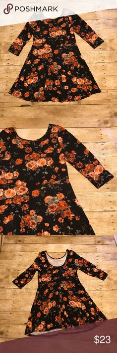 Floral skater dress Size xl. One clothing company. Black skater dress. A line skirt. Elbow length sleeves. Low neckline in back. 18 bust 35 length. All measurements are approximate one clothing Dresses