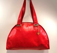 Pour Moi? Mais bien sur!! (For me? But of course!) French Company-Lipstick Red Leather Dome Tote. (www.handbagconsignmentshop.com)