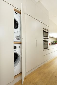 Small Kitchen Designs Washing machine and dryer hidden in a kitchen cupboard - A utility room is key for keeping appliances and laundry separate from open-plan living spaces. Here's how to create one, whatever space you have available