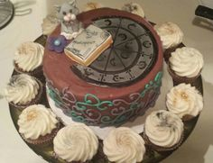 A happy birthday to my friend and a tribute to the Mistborn Trilogy! A cat for Vin. Elend's book. And a flower for the end. Along with part of the metal chart! Then cupcakes with different metallic glitter for the metals. Long live Mistborn!