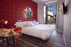 Posada Del Dragón Madrid This boutique hotel is located in Madrid's La Latina district, an area known for its tapas bars. It offers stylish rooms with free Wi-Fi and a flat-screen TV with satellite channels.
