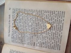 Delicate gold coloured heart bracelet by Estella Bartlett £15.00