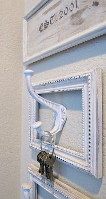 Old picture frames painted and new Hooks = key holder for the Foyer