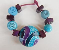 Set 11 beads purple and turquoise . The set consists of 11 beads , ceramic black and white . By Mª Carmen Rodriguez ( majoyoal ) https://www.facebook.com/groups/CeramicArtBeadMarket