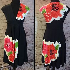 MAGGY LONDON FLORAL PRINT DRESS Gorgeous black dress with a gorgeous floral print. V-neck with empire waist.. Gently used Maggy London Dresses Midi