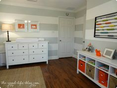grey & white striped walls and pops of color baby room