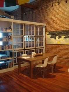 using old windows and a bookcase to divide a huge space.  lovely!