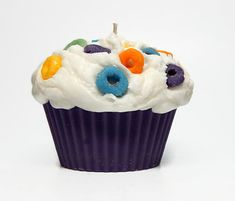 Extra Large Cupcake Candle  Approximately 11 ounces by weight  Scented with Fruit Rings fragrance oil  Topped with wax Froot Loops  Packaged