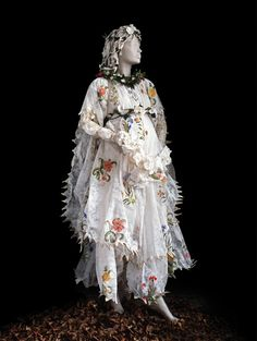 This artist, Isabelle de Borchgrave, recreates these antique fashions from paper. It's all hand painted and hand made.