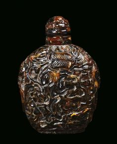 A relief amber snuff bottle, China, 19th century
