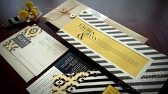 Stripe and Ikat Wedding Invitation Suite with grommeted informational pieces www.lovemdesign.com
