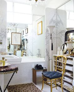 Fabrizio Rollo's São Paulo apartment - ELLE DECOR, gold, marble, white and black, yellow bathroom