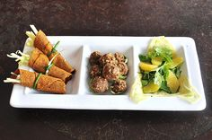 Carrot Rolls with Cabbage and Apple Slaw, Walnut Balls in Brussels Sprout Cups, Shaved Fennel, Baby Arugula and Orange Salad by tofu666, via Flickr