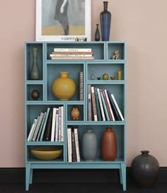 I'd like something like this to put favorite books on. I have just the perfect vases too!