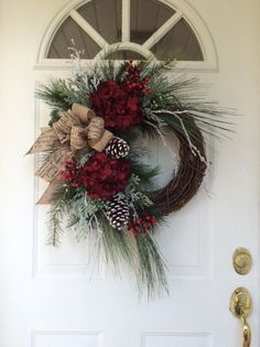 Christmas Wreath-Winter Wreath-Christmas Wreath for Front Door-Holiday Hydrangea Wreath-Designer Wreath-Snowy Wreath-Traditional Wreath-Berry Wreath This beautiful, sophisticated wreath is a nod to all the traditional elements of the Christmas holiday. Abundant pine boughs, snow covered white pine and frosty cedar branches create a lush evergreen bed on which rests spectacular rich burgundy hydrangea, clusters of vibrant red berries, snowy birch branches and festive snow-tipped pine cones…