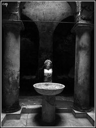 Bust and stone basin in Herculanums thermae