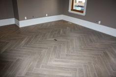 One of the options I would like. wood look herringbone tile