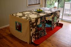 Table cloth fort that fits perfectly over your own kitchen/dining room table. So cute! I use to make forts all the time under tables as a kid.