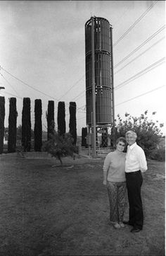 Ivan and Elke Forbes with their wind turbine, 1984. The turbine was built by Solar World Energy Systems. More sturdy than a conventional windmill, the turbine generated electricity for the couple's Sylmar home on windy days through a standard power line. The turbine was only one of several measures the Forbes took to make their home more energy-efficient. Robert and Betty Franklin Collection. San Fernando Valley History Digital library.