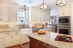 This is IT! White cabinetry & walnut island with a contemporary craftsman style.