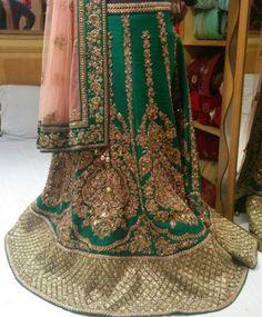 Dark green lehenga by Ram kishan sarees