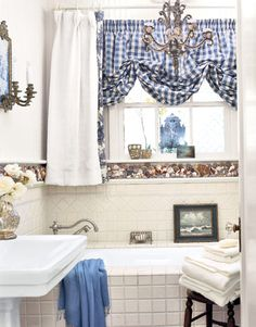 Bathroom Design Ideas – Pictures of Bathroom Designs - Country Living    I like the idea of using shells/sand in tall glass containers...beachy?