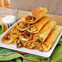Chicken and Cream Cheese Taquitos | 3 cups cooked shredded chicken 6 oz cream cheese, softened 1/3 cup sour cream 1/2 cup salsa 1 1/2 cups shredded sharp cheddar cheese 1 1/2 cups chopped baby spinach, stems removed salt and pepper, to taste 9 - 10 (6-inch) flour tortillas vegetable or canola oil, for frying