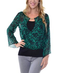 This Green Sheer Lace-Print Surplice Top is perfect! #zulilyfinds