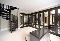 Master wardrobe with mirrored doors, island & seat, plus a staircase to... ?