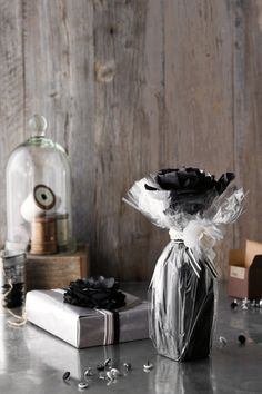 Tissue paper and cellophane needn't be your wrapping of last resort. Simply layer them for impact and team with an accessory
