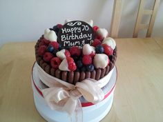 Birthday cake with chocolate fingers and chocolate dipped strawberries