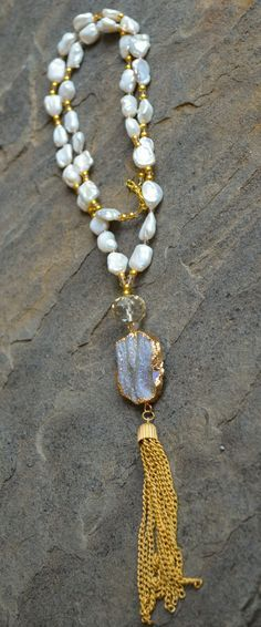 "Freshwater pearls, crystals and gold beads with druzy pendant and gold chain tassel. Necklace is approximately 32"" long with a 3"" extender. May have slight vari"