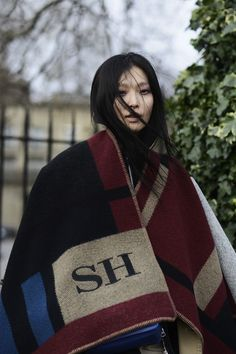 Fashion in the streets of London :: Sung Hee in her monogrammed Burberry poncho