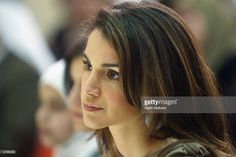 Queen Rania of Jordan joins schoolgirls December 10, 2003 in Amman,... News Photo | Getty Images