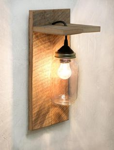 This mason jar light fixture is the perfect wall sconce for rustic, country, or western décor. Made from reclaimed barn wood, it looks great with or without the rope detail. Hang one on either side of the bed or bring a rustic touch to your living room. ROPE ACCENT OPTIONAL This sconce is available
